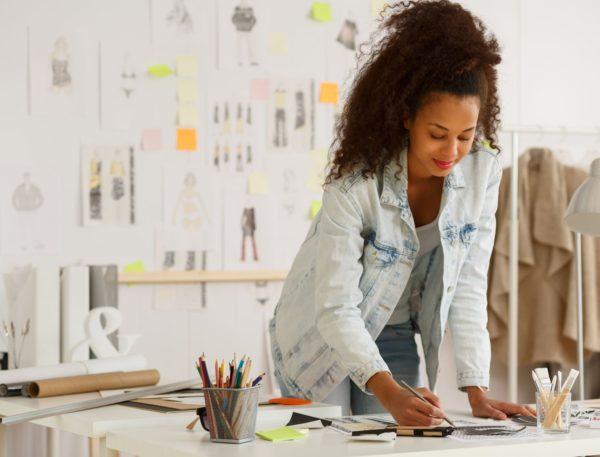 47344378 - african american fashion designer working in atelier